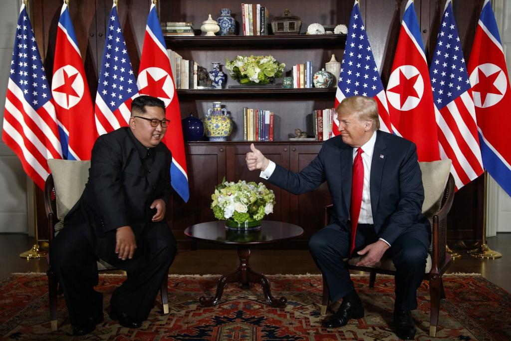 President Donald Trump meets with North Korean leader Kim Jong Un on Sentosa Island in Singapore on June 12, 2018. (AP Photo/Evan Vucci)
