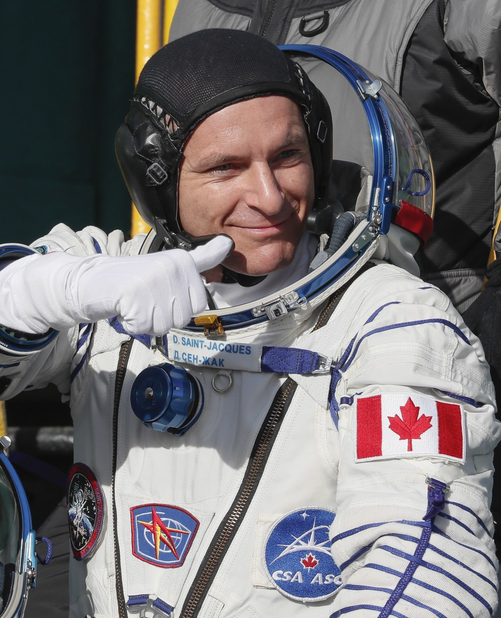 David Saint Jacques, crew member of the mission to the International Space Station, ISS, waves as he boards the rocket prior to the launch of Soyuz-FG