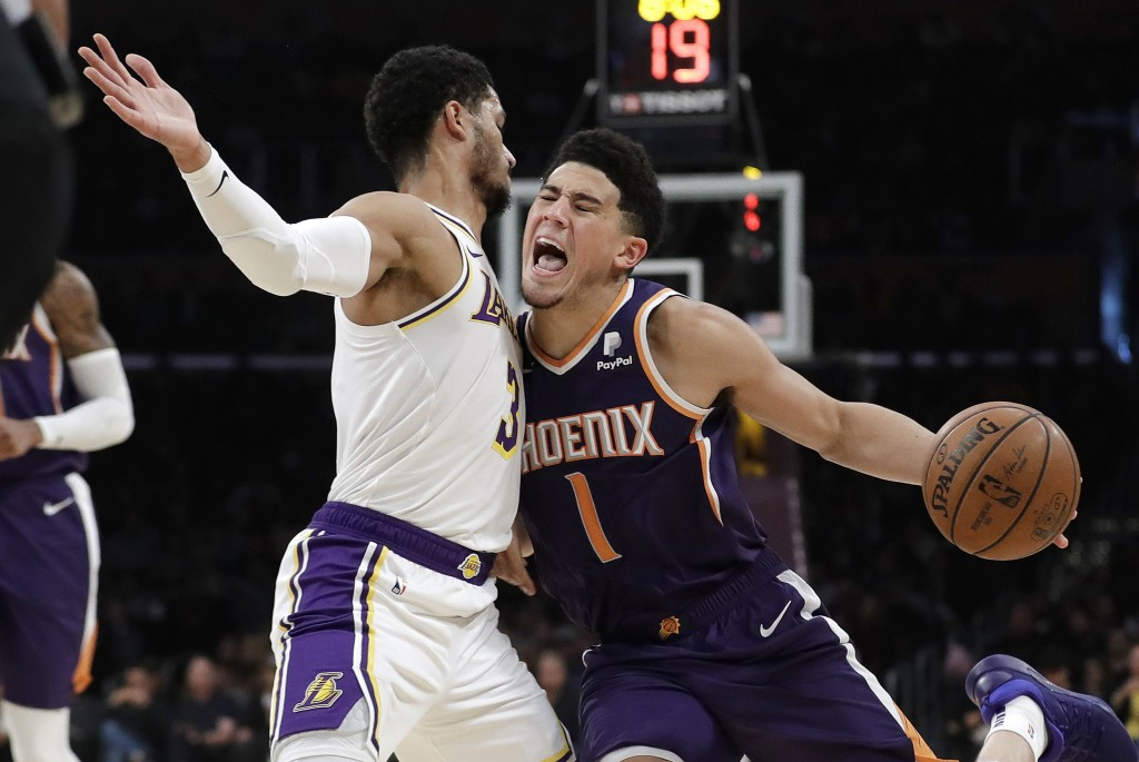 Phoenix Suns' Devin Booker (1) is defended by Los Angeles Lakers' Josh Hart (3) during the first half of an NBA basketball game Sunday, Dec. 2, 2018,