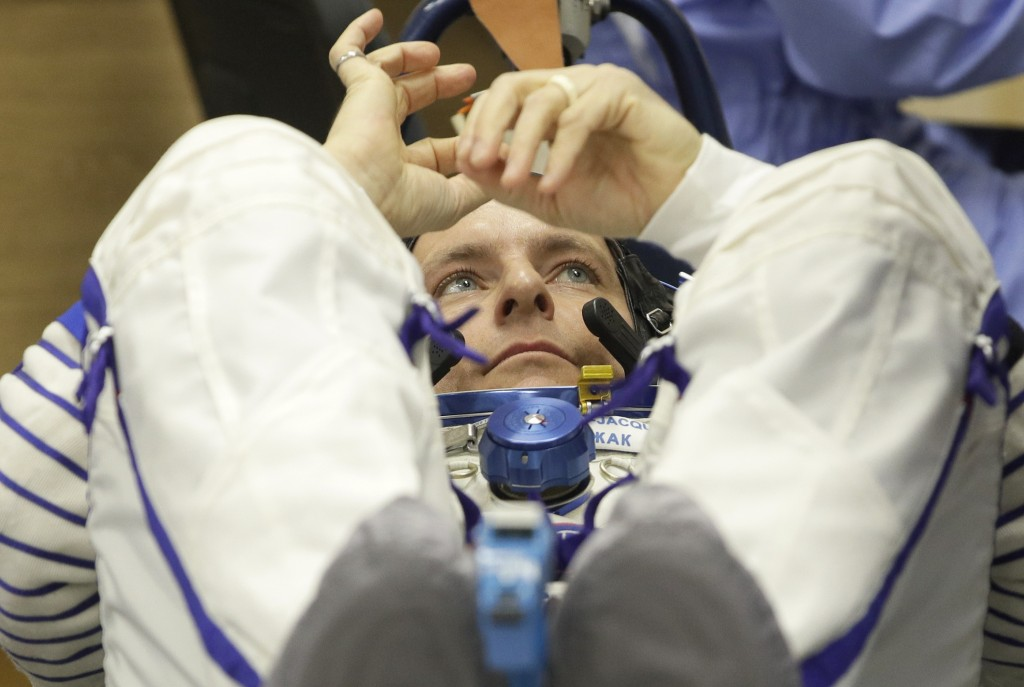 CSA astronaut David Saint Jacques, member of the main crew of the expedition to the International Space Station (ISS),  during an inspection of his sp...