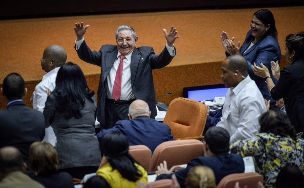 Outgoing President Raul Castro raises his arms in celebration after Miguel Diaz-Canel was elected as the island nation's new president, at the Nationa