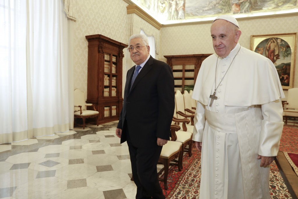 Pope Francis, right, walks with Palestinian President Mahmoud Abbas during a private audience at the Vatican, Monday, Dec. 3, 2018. (AP Photo/Andrew M