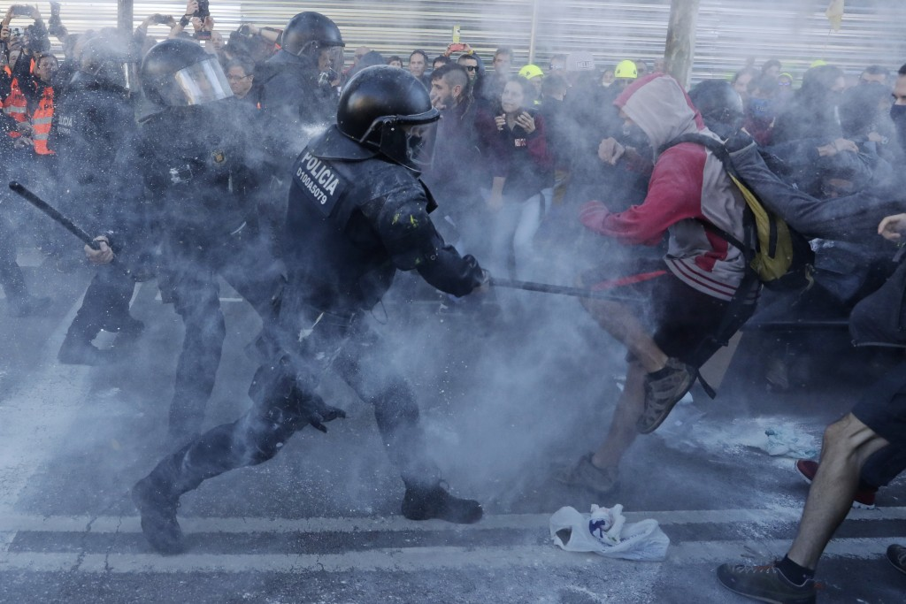 Police charge against protesters during a demonstration by Committees for the Defense of the Republic in Barcelona, Spain, on Nov. 10, 2018. The grass...