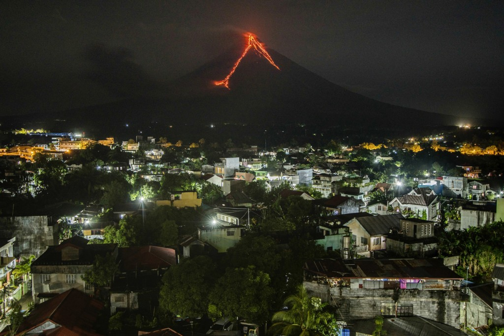 Lava flows down the slopes of the Mayon volcano in the Philippines, seen from Legazpi city, 340 kilometers (210 miles) southeast of Manila, on Jan. 16...