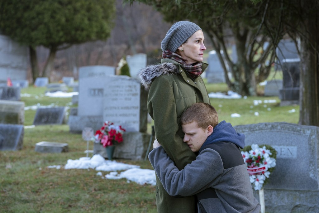 "This image released by Roadside Attractions shows Lucas Hedges, right, and Julia Roberts in a scene from ""Ben is Back."" (Mark Schafer/Roadside Attract..."
