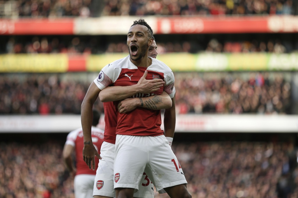 Arsenal's Pierre-Emerick Aubameyang celebrates after scoring his side's opening goal from the penalty spot during the English Premier League soccer ma