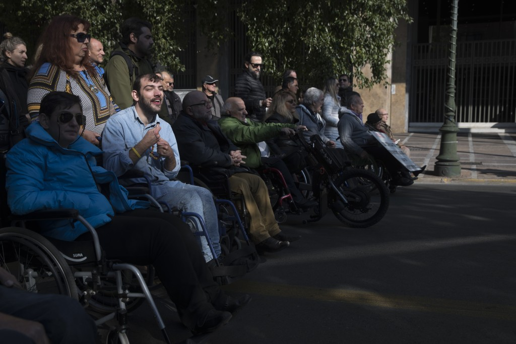 People protest for disabled rights in central Athens on Monday, Dec. 3, 2018. Rallies were held in several Greek cities to mark the U.N. International...