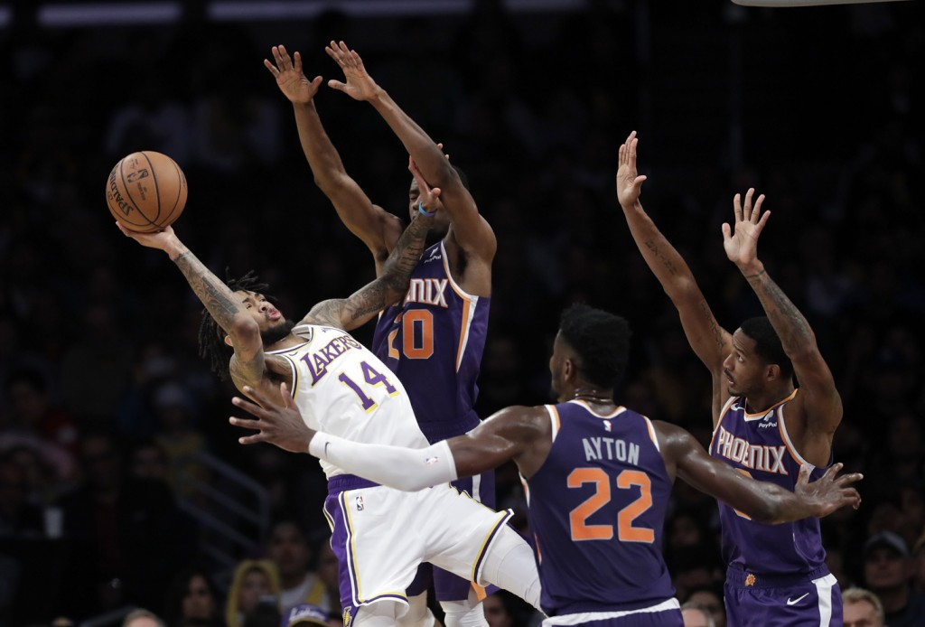 Los Angeles Lakers' Brandon Ingram (14) attempts a...