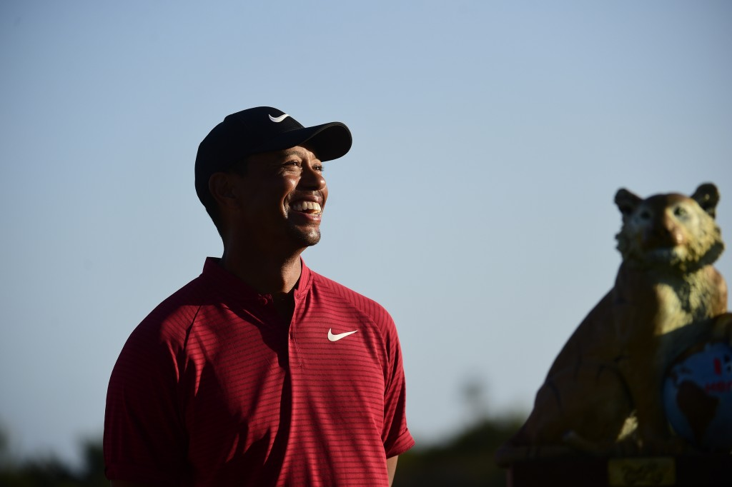 U.S. golfer Tiger Woods stands near the Hero World Challenge trophy before presenting it to Spain's Jon Rahm at Albany Golf Club in Nassau, Bahamas, S