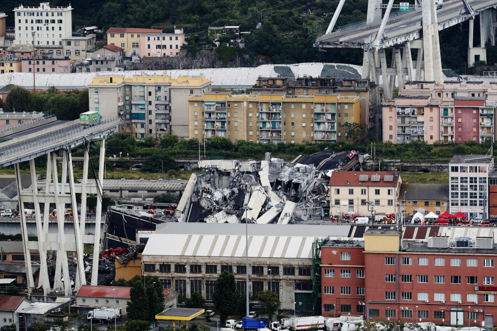 Cars are blocked on the Morandi highway bridge after a large section of it collapsed in Genoa, Italy, on Aug. 14, 2018, during a sudden and violent st