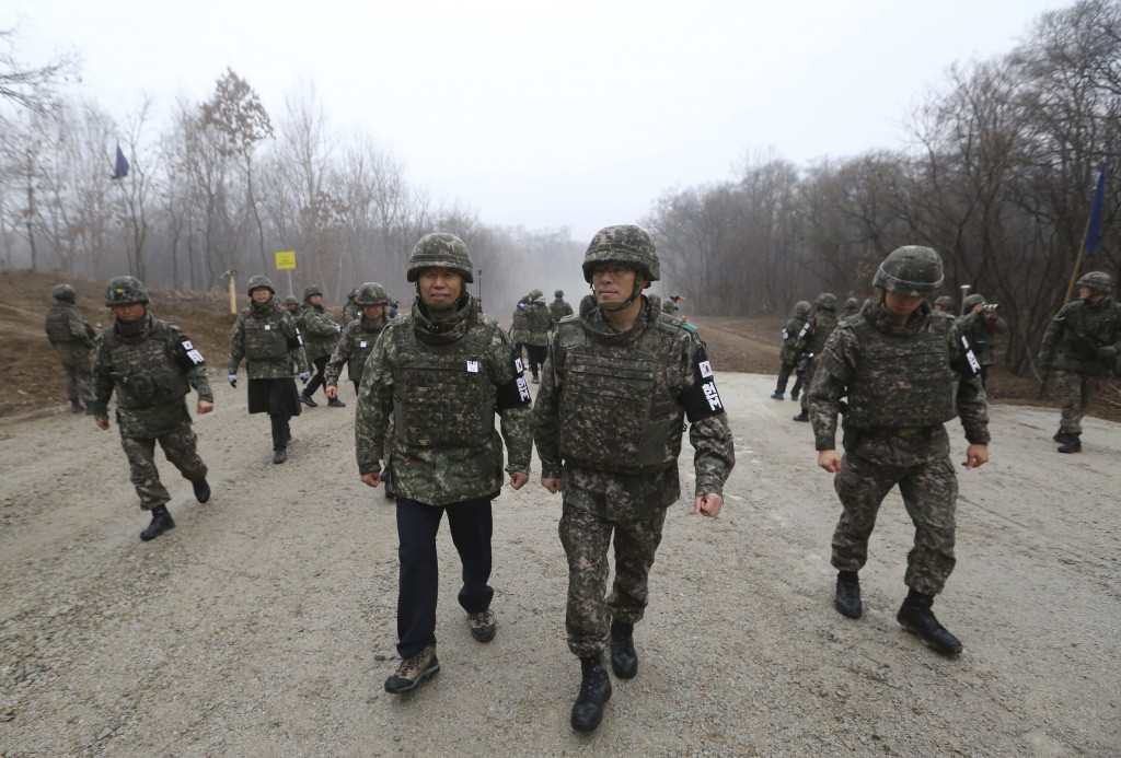 In this Monday, Dec. 3, 2018, file photo, South Korean Gangwon Province Governor Choi Moon-soon, center left, is escorted by South Korean army soldier
