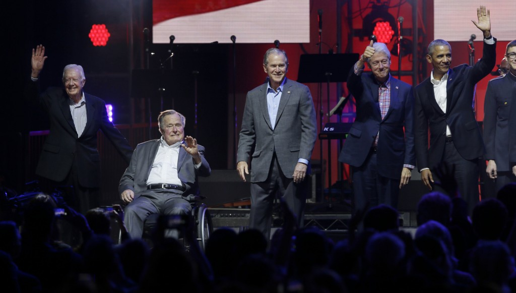 FILE - In this Oct. 21, 2017, file photo, former Presidents from right, Barack Obama, Bill Clinton, George W. Bush, George H.W. Bush and Jimmy Carter