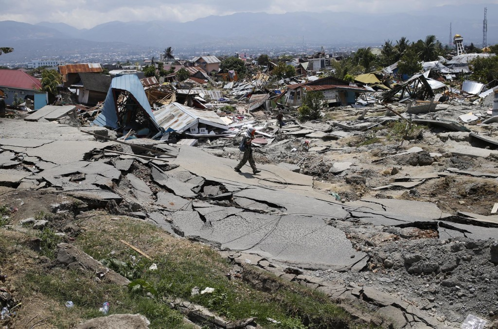 A man walks through the Balaroa neighborhood in Palu, Central Sulawesi, Indonesia, on Oct. 2, 2018, four days after a massive earthquake struck the re...