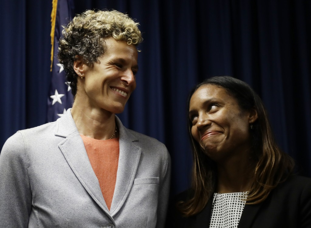 Accuser Andrea Constand, left, reacts at a news conference with prosecutor Kristen Feden after Bill Cosby was sentenced to three to 10 years for sexua...