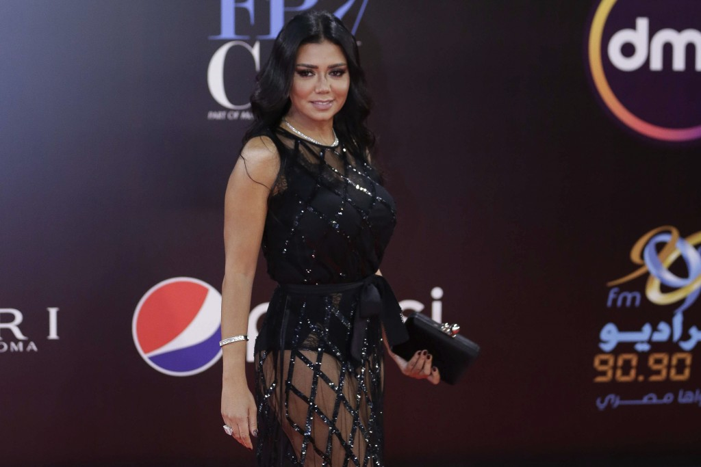 This photo taken on Nov. 29, 2018 shows Egyptian actress Rania Youssef on the red carpet of the Cairo International Film Festival. The actress facing ...