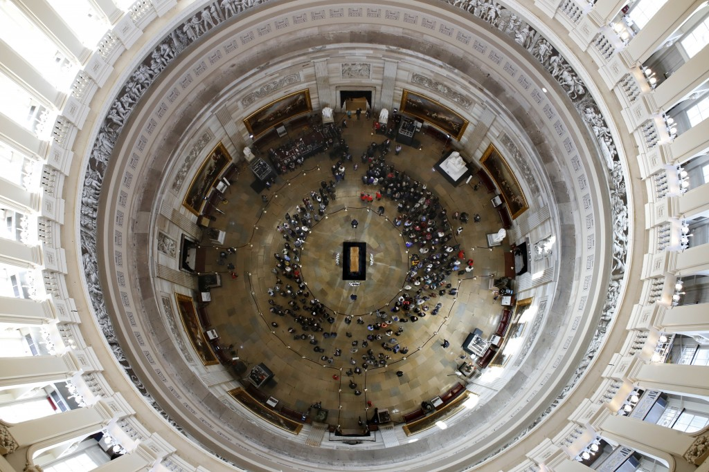 Visitors pay their respects as the casket of Reverend Billy Graham lies in honor at the Rotunda of the U.S. Capitol Building in Washington on Feb. 28,...