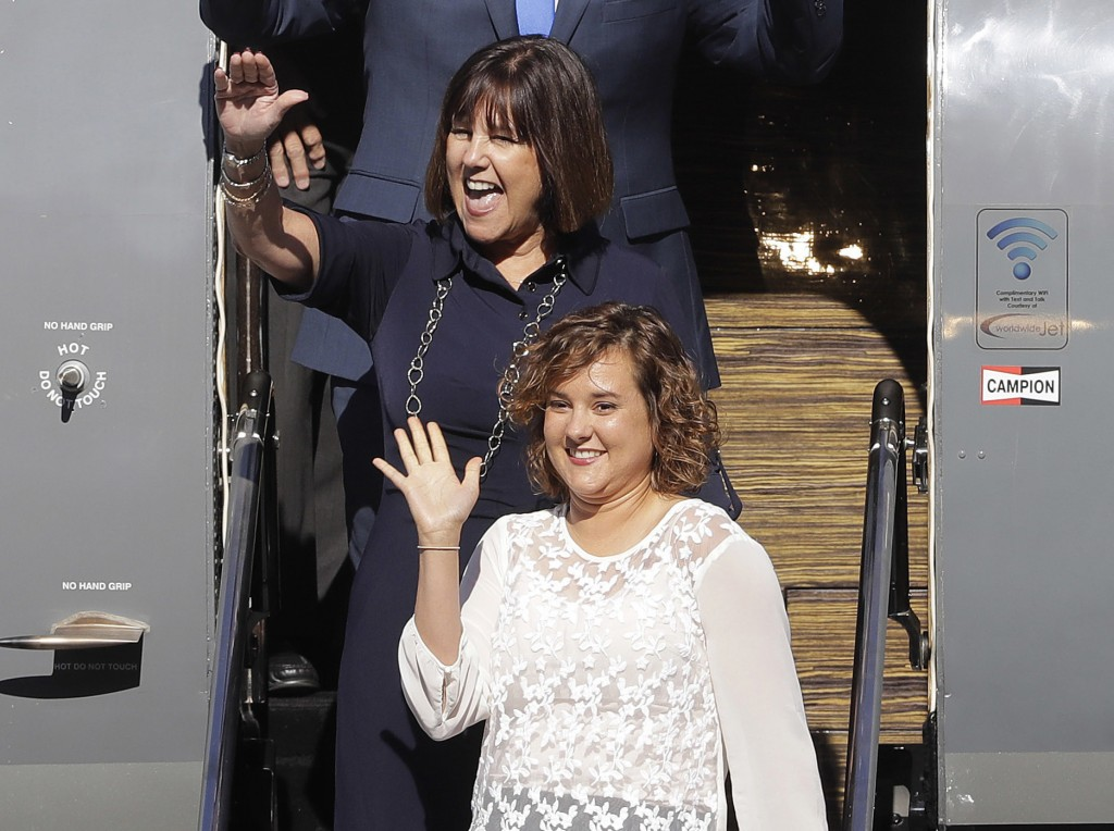 FILE - In this July 16, 2016, file photo, Karen Pence, background, and her daughter Charlotte arrive for a welcome home rally in Zionsville, Ind. The