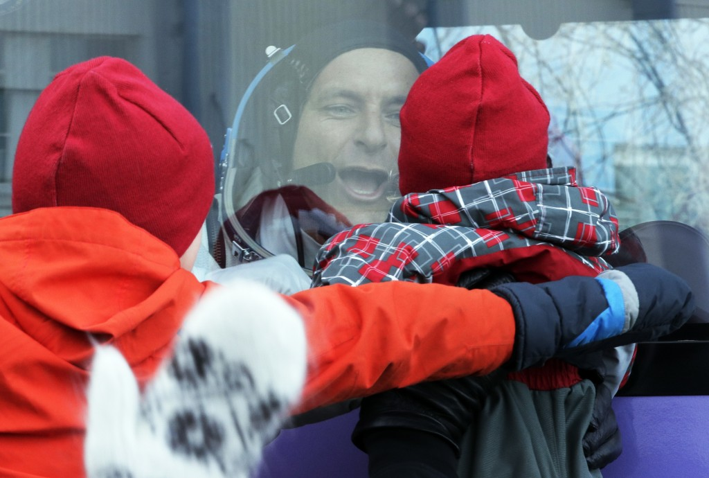 CSA astronaut David Saint Jacques, member of the main crew to the International Space Station (ISS), interacts with his children from a bus prior to t...