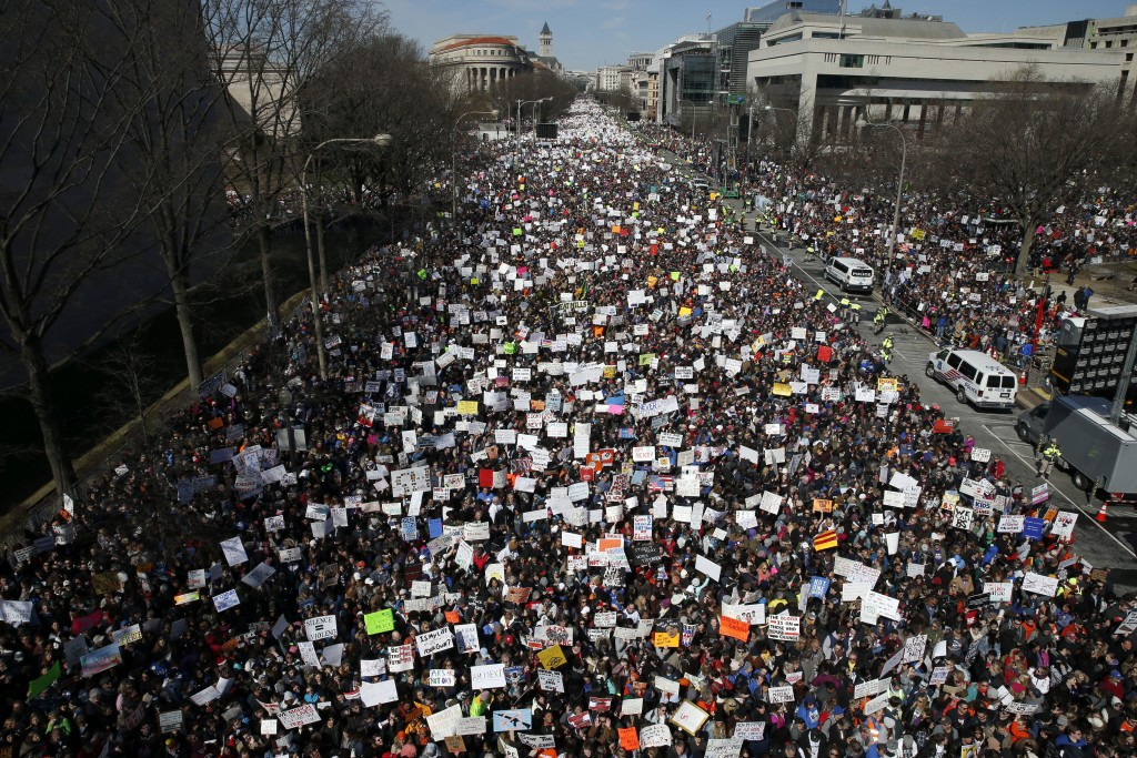 """Looking west toward the White House, people fill Pennsylvania Avenue in Washington during the """"March for Our Lives"""" rally in support of gun control on..."""