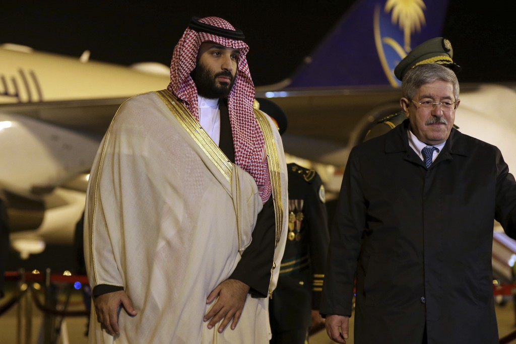 Saudi Crown Prince Mohammed bin Salman, left, is greeted by Algerian Prime Minister Ahmed Ouyahia upon his arrival at Algiers international airport, A...