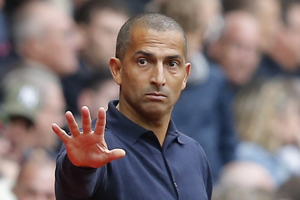 FILE - In this Sept.23, 2018 file photo, Rennes' coach Sabri Lamouchi gestures during the French League One soccer match between Rennes and Paris-Sain...