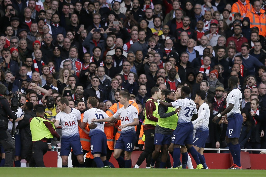 Tottenham and Arsenal players fight during the English Premier League soccer match between Arsenal and Tottenham Hotspur at the Emirates Stadium in Lo