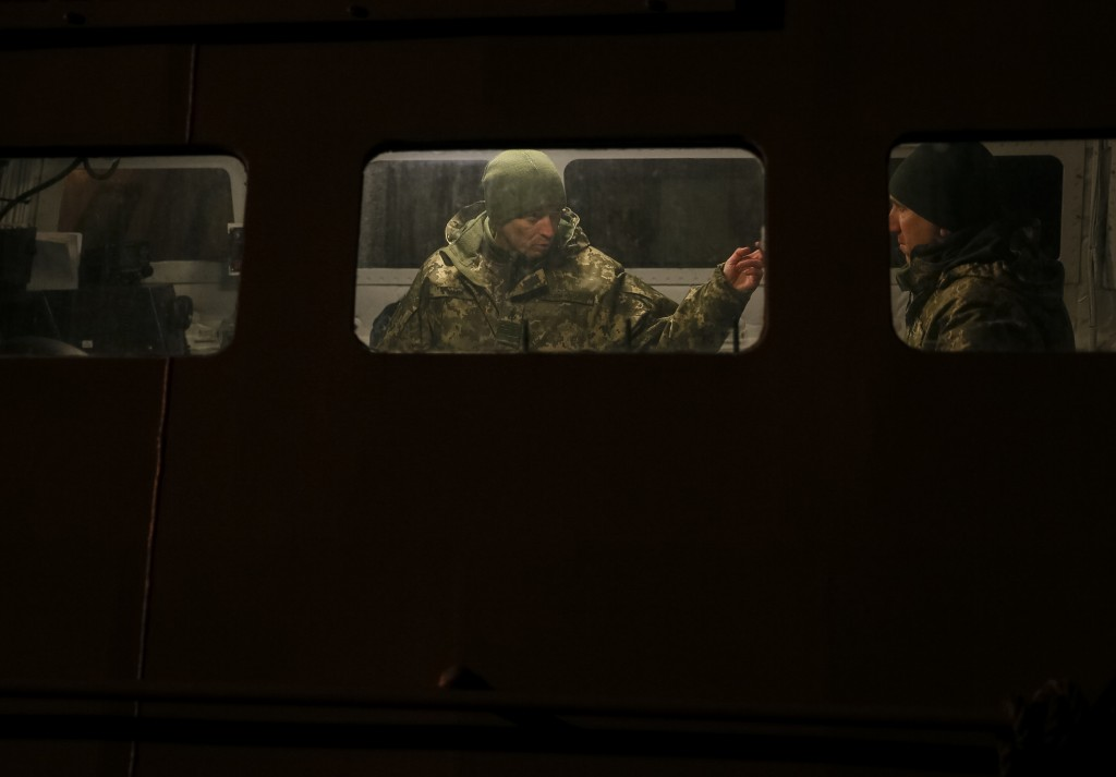 Ukrainian servicemen are seen at a naval ship in the Azov Sea port of Mariupol, Ukraine, Sunday, Dec. 2, 2018. Ukraine's leader called on Germany and