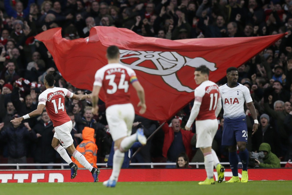 Arsenal's Pierre-Emerick Aubameyang, left, celebrates after scoring his side's second goal during the English Premier League soccer match between Arse