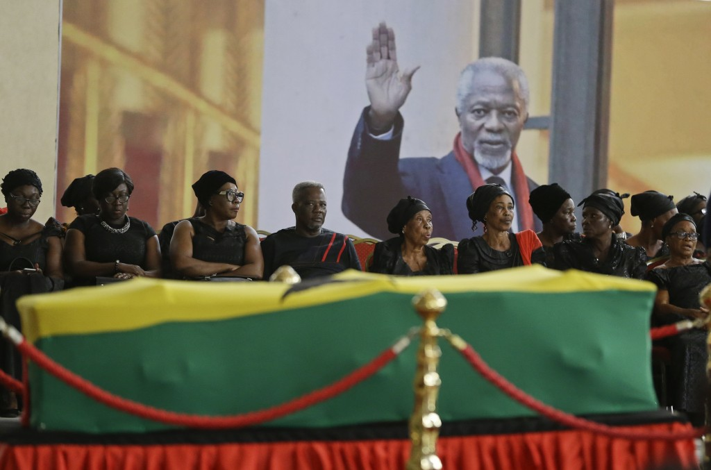 Mourners pay their respects at the coffin of former United Nations Secretary-General Kofi Annan at the Accra International Conference Center in Ghana ...