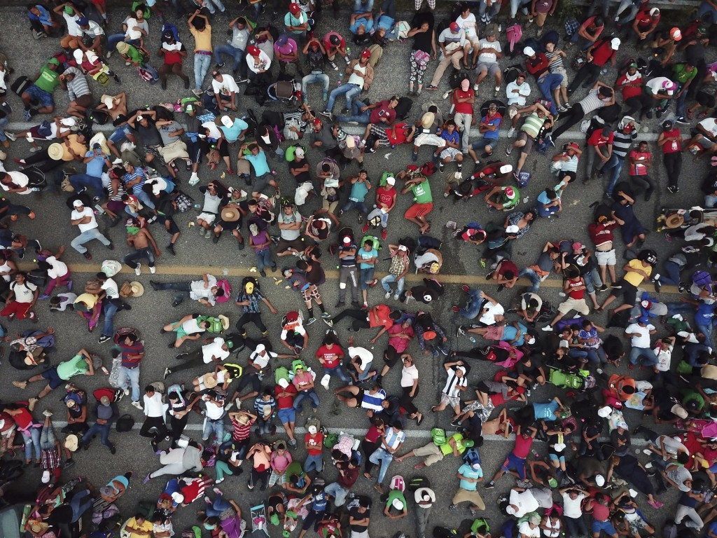Members of a migrant caravan bound for the United States rest on a road between the Mexican states of Chiapas and Oaxaca after federal police briefly ...