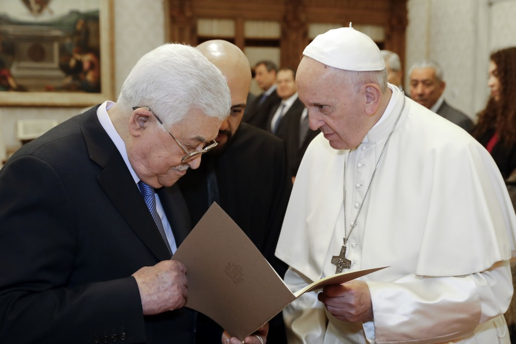 Pope Francis, right, and Palestinian President Mahmoud Abbas exchange gifts during a private audience at the Vatican, Monday, Dec. 3, 2018. (AP Photo/
