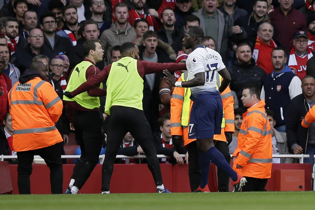 Tottenham's Moussa Sissoko, right, agrees with Arsenal's Stephan Lichtsteiner, left, after Tottenham's Harry Kane scored his side's opening goal from