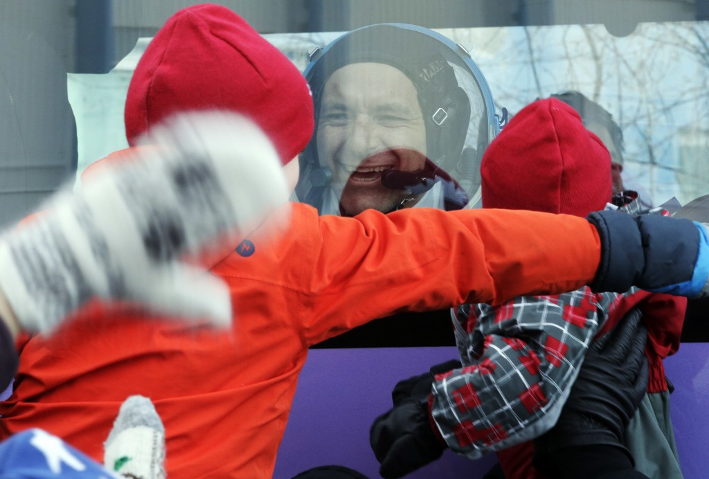 CSA astronaut David Saint Jacques, member of the main crew to the International Space Station (ISS), interacts with his children from a bus prior to t