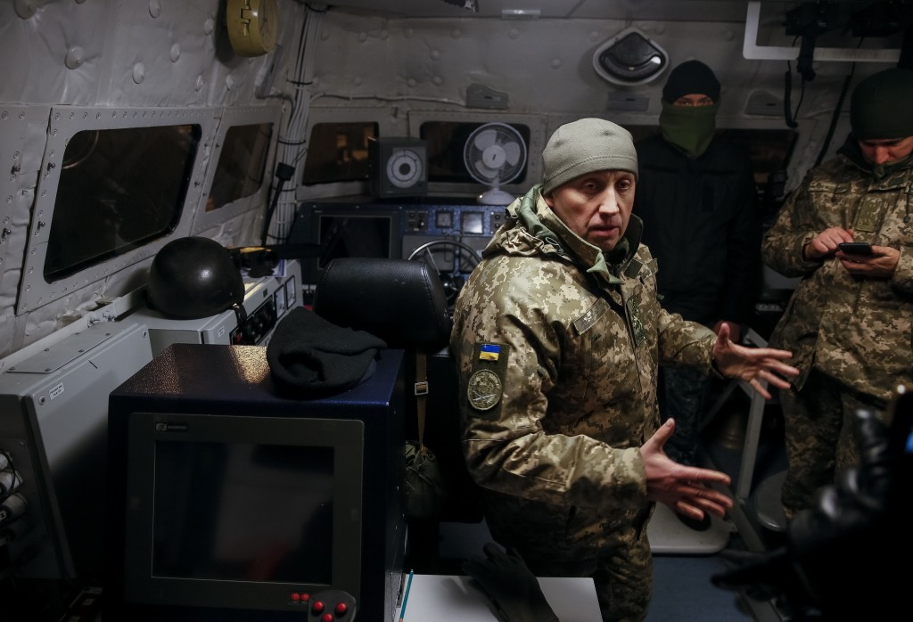 Ukrainian servicemen are seen aboard a naval ship in the Azov Sea port in Mariupol, Ukraine, Sunday, Dec. 2, 2018.  Ukraine's leader called on Germany