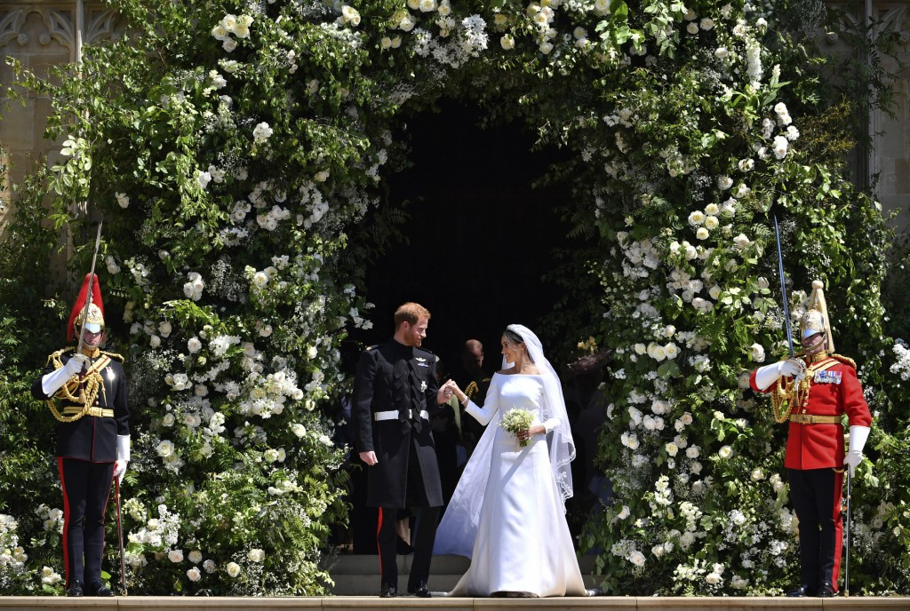 Prince Harry and Meghan Markle leave St. George's Chapel in Windsor Castle after their wedding ceremony in Windsor, England, near London, on May 19, 2...
