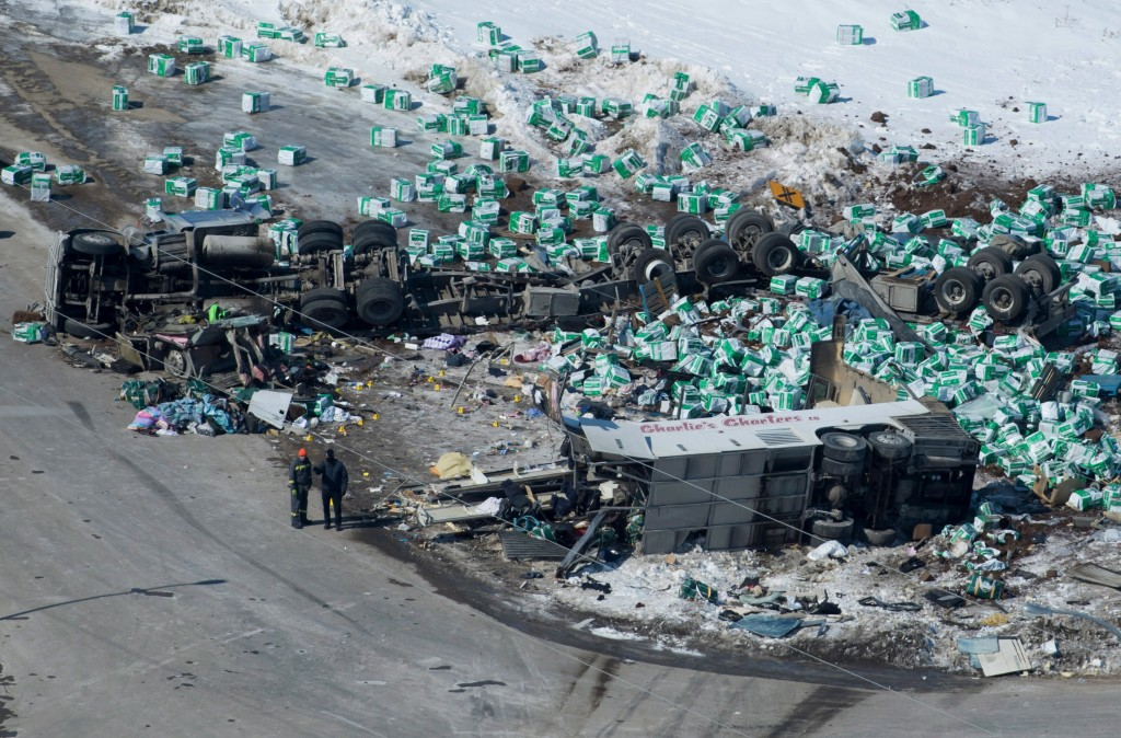 Emergency personnel work at the scene of a fatal crash outside of Tisdale, Saskatchewan, Canada, on April, 7, 2018, the morning after a bus carrying t...
