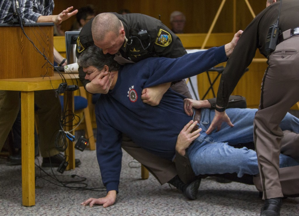 Eaton County Sheriff's deputies restrain Randall Margraves, father of three victims of Larry Nassar, on Feb. 2, 2018, in Eaton County Circuit Court in...