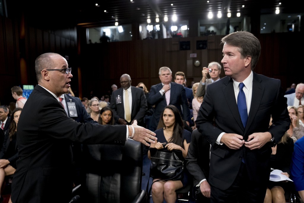 Fred Guttenberg, left, the father of Jamie Guttenberg, who was killed in the high school shooting in Parkland, Fla., attempts to shake hands with Bret