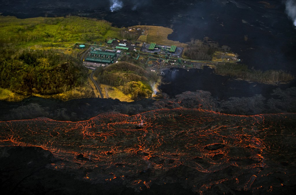 Lava from the Kilauea volcano flows near the Puna Geothermal Venture power plant in Pahoa, Hawaii, on June 10, 2018. (AP Photo/L.E. Baskow)