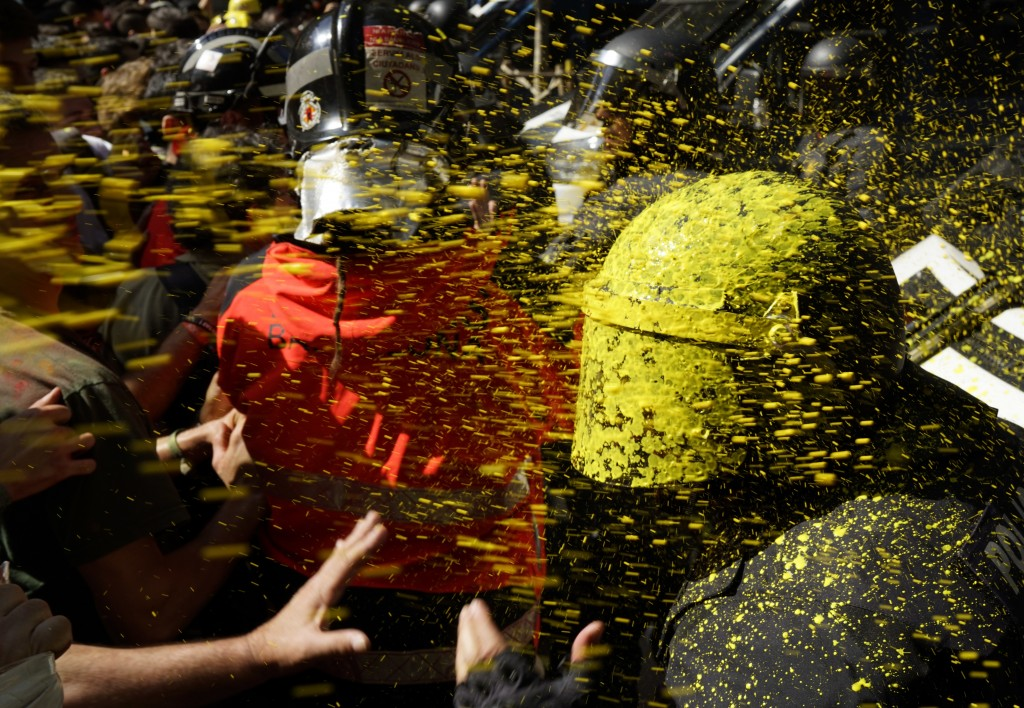 Pro independence demonstrators throw paint at Catalan police officers during clashes in Barcelona, Spain, on Sept. 29, 2018, as tensions increase befo...
