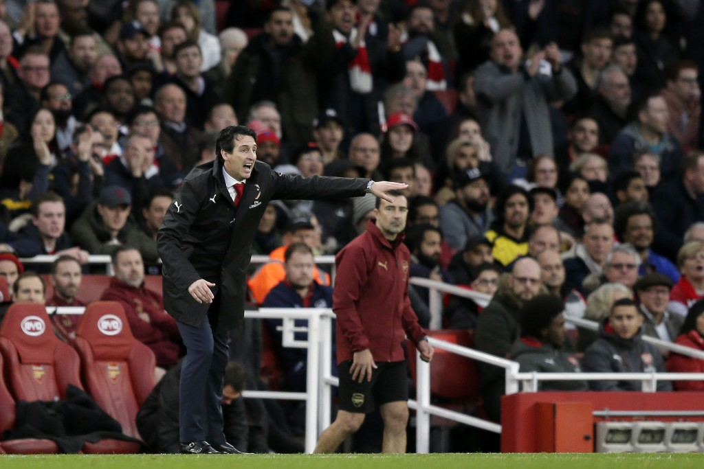 Arsenal manager Unai Emery gives instructions from the side line during the English Premier League soccer match between Arsenal and Tottenham Hotspur ...