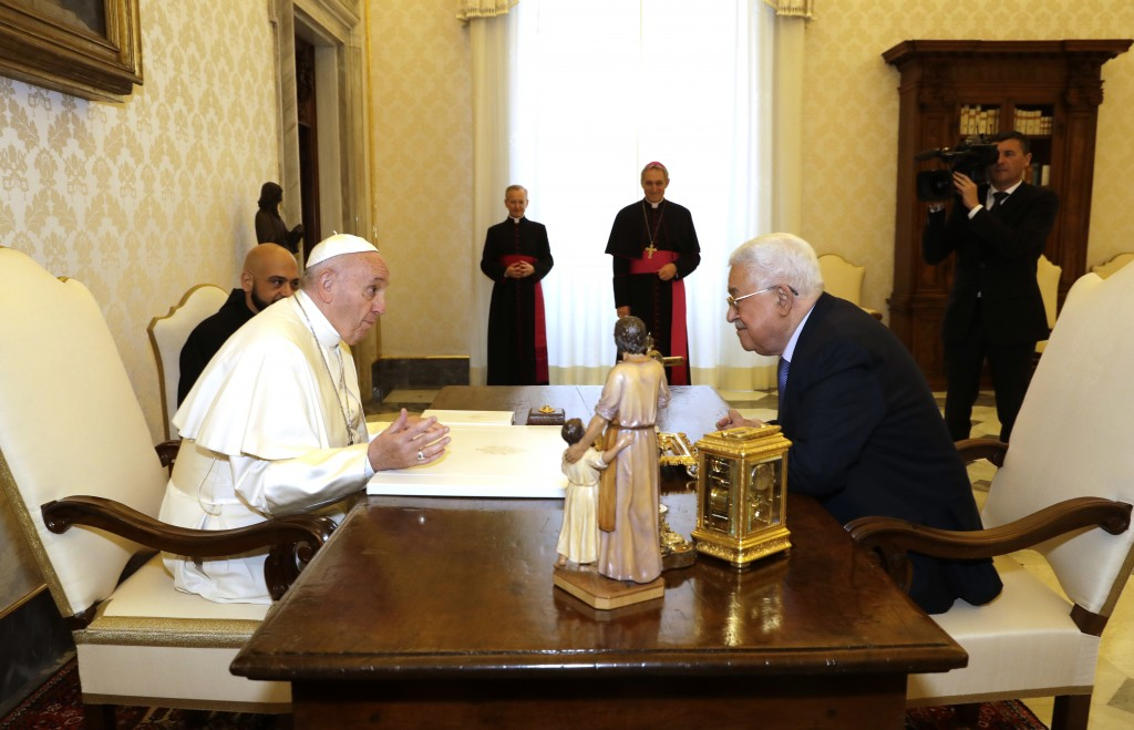 Pope Francis, left, meets Palestinian President Mahmoud Abbas during a private audience at the Vatican, Monday Dec. 3, 2018. (AP Photo/Andrew Medichin