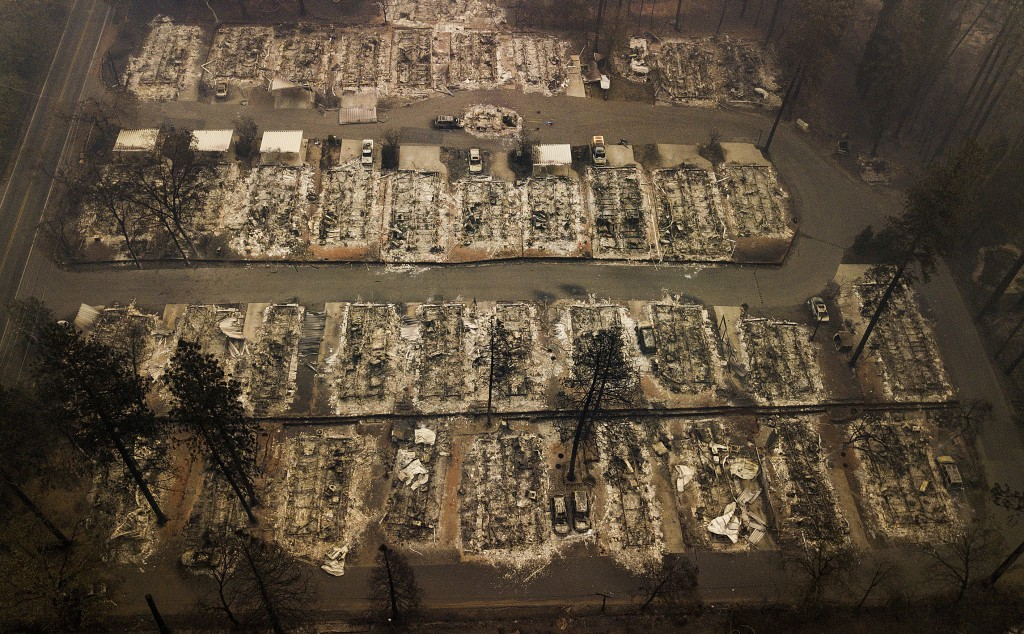 Ashes and debris are all that remain where houses once stood in Paradise, Calif., on Nov. 15, 2018, after a wildfire destroyed the town. (AP Photo/Noa