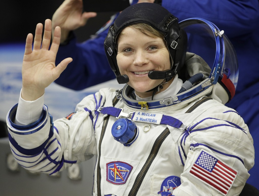 U.S. astronaut Anne McClain, member of the main crew of the expedition to the International Space Station (ISS), gestures prior to the launch of Soyuz
