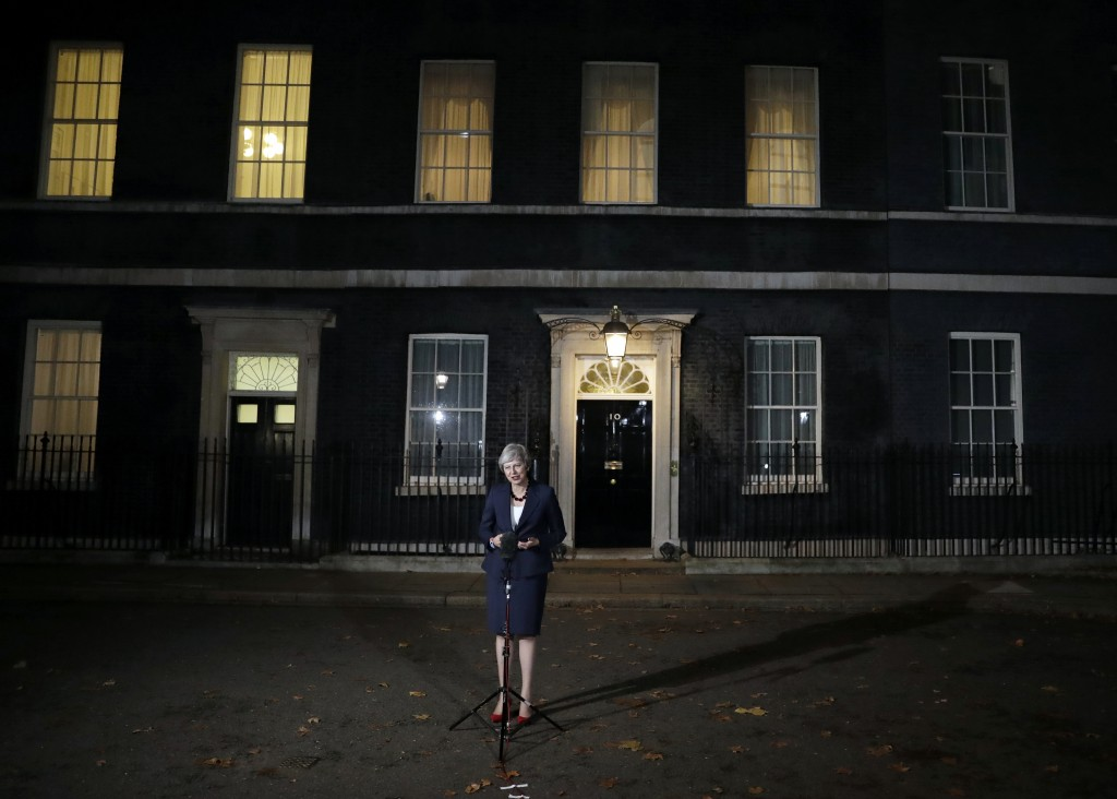 """Britain's Prime Minister Theresa May announces that her Cabinet has agreed to a draft Brexit deal with the European Union after """"impassioned"""" debate, ..."""