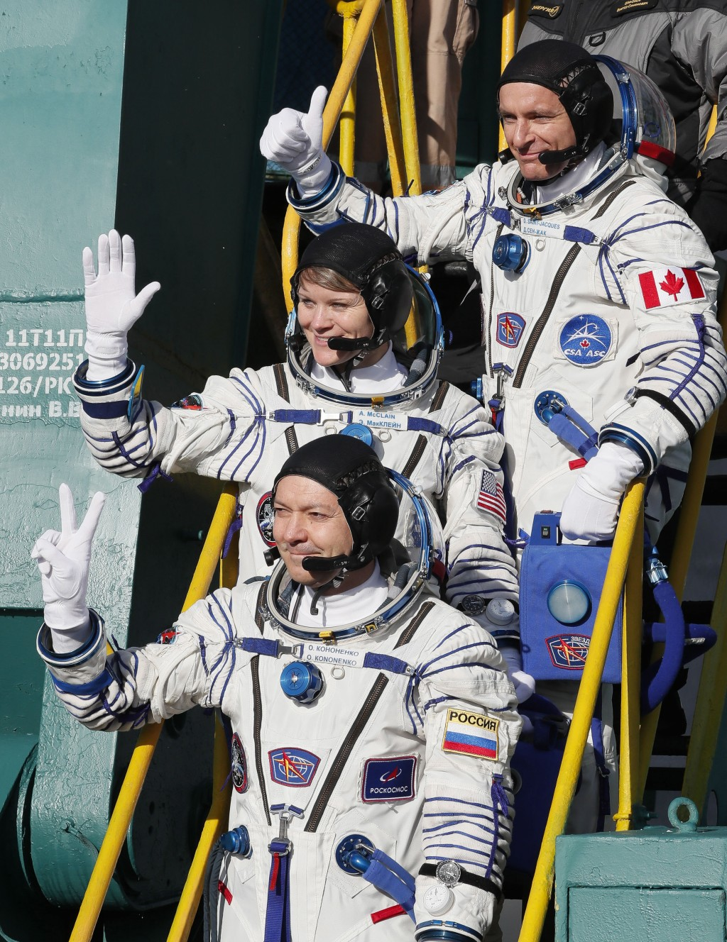 U.S. astronaut Anne McClain, centre, Russian cosmonaut Оleg Kononenko, bottom, and CSA astronaut David Saint Jacques, crew members of the mission to t
