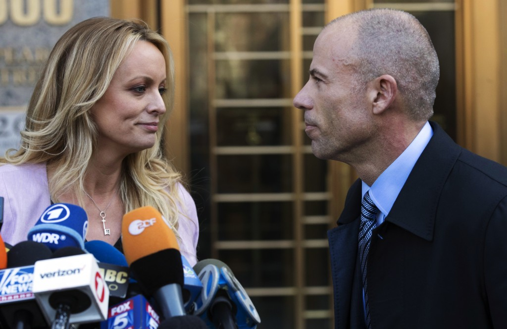 Adult film actress Stormy Daniels, left, stands with her lawyer, Michael Avenatti, after speaking outside federal court in New York on April 16, 2018....