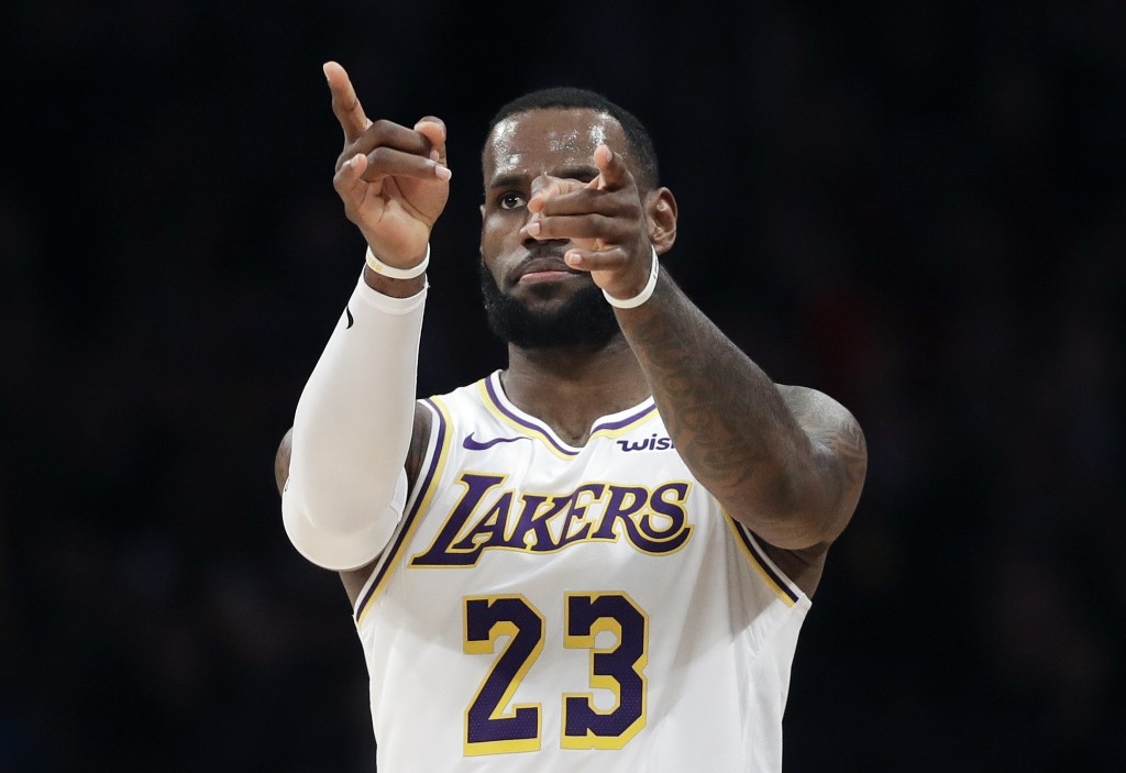 Los Angeles Lakers' LeBron James (23) gestures after scoring against the Phoenix Suns during the first half of an NBA basketball game Sunday, Dec. 2,