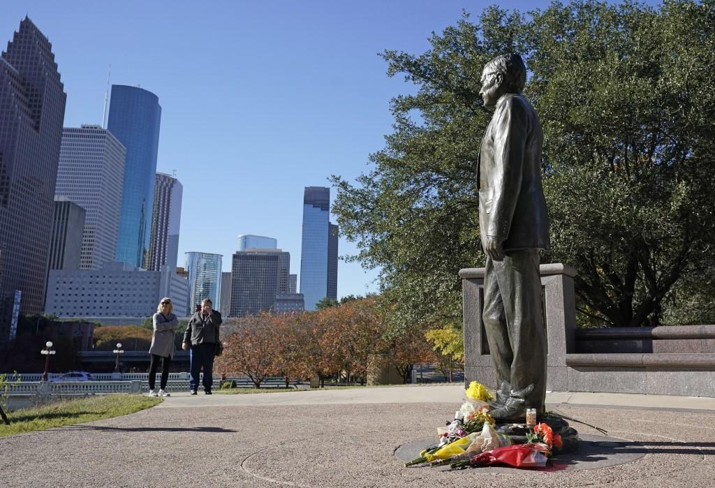 Deitz Kracker, left, and Marg Frazier visit a statue of former President George H.W. Bush in downtown Houston, Sunday, Dec. 2, 2018. Bush is returning...
