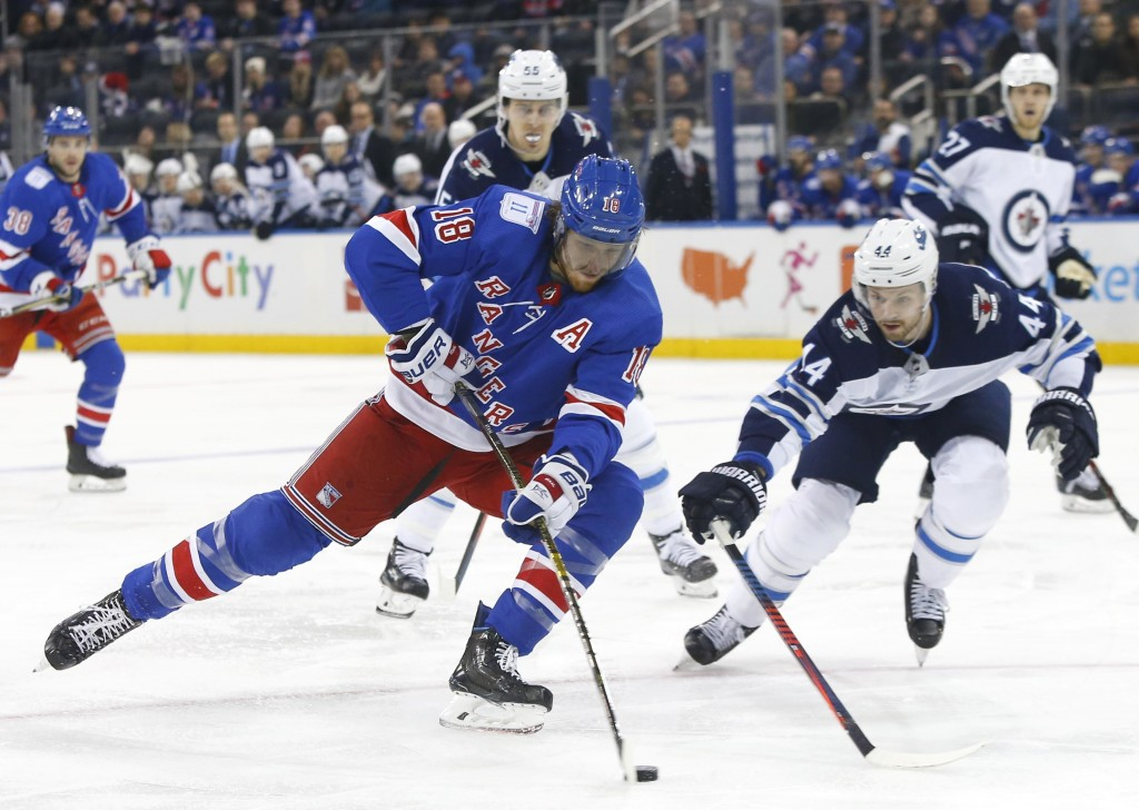 New York Rangers defenseman Marc Staal (18) controls the puck against Winnipeg Jets defenseman Josh Morrissey (44) during the second period of an NHL